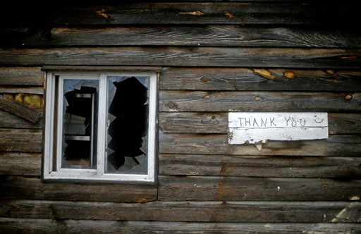 A sign hangs next to a damaged window outside a barbecue restaurant after a tornado struck, Wednesday, Jan. 30, 2013, in Adairsville, Ga. A fierce storm system that roared across Georgia has left at least one person dead after it demolished buildings and flipped vehicles on Interstate 75 northwest of Atlanta.  <span class=meta>(AP Photo&#47; David Goldman)</span>
