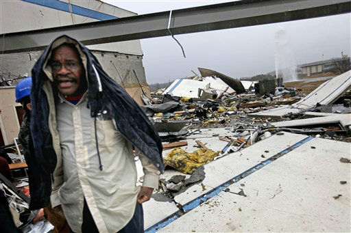"<div class=""meta ""><span class=""caption-text "">Workers look for personal belongings following a tornado at the Daiki plant, a metal fabrication company, Wednesday, Jan. 30, 2013, in Adairsville, Ga. A fierce storm system that roared across Georgia has left at least one person dead after it demolished buildings and flipped vehicles on Interstate 75 northwest of Atlanta.  (AP Photo/ David Goldman)</span></div>"