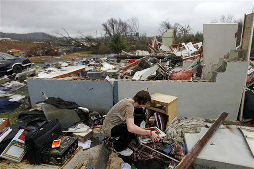 "<div class=""meta ""><span class=""caption-text "">Will Carter, 15, gathers some personal items  upon arriving home from school following a tornado, Wednesday, Jan. 30, 2013, in Adairsville, Ga. A fierce storm system that roared across Georgia has left at least one person dead after it demolished buildings and flipped vehicles on Interstate 75 northwest of Atlanta.  (AP Photo/ David Goldman)</span></div>"