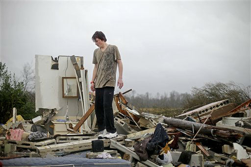 "<div class=""meta ""><span class=""caption-text "">Will Carter, 15, surveys the damage to his house upon arriving home from school following a tornado, Wednesday, Jan. 30, 2013, in Adairsville, Ga. A fierce storm system that roared across Georgia has left at least one person dead after it demolished buildings and flipped vehicles on Interstate 75 northwest of Atlanta. (AP Photo/ David Goldman)</span></div>"