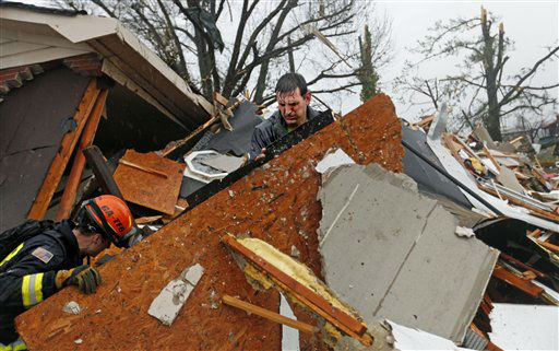 Nathan Varnes, of Cartersville, Ga., right, helps Georgia Search and Rescue firefighter Billy Green, left, search a destroyed home for a dog after a tornado struck, Wednesday, Jan. 30, 2013, in Adairsville, Ga. A fierce storm system that roared across Georgia has left at least one person dead after it demolished buildings and flipped vehicles on Interstate 75 northwest of Atlanta.  <span class=meta>(AP Photo&#47; David Goldman)</span>
