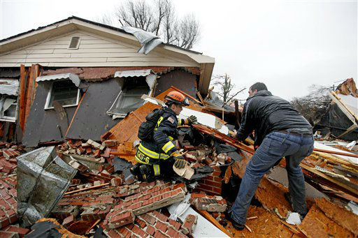Nathan Varnes, of Cartersville, Ga., right, helps Georgia Search and Rescue firefighter Billy Green, left, search a destroyed home for a dog after a tornado struck, Wednesday, Jan. 30, 2013, in Adairsville, Ga.  <span class=meta>(AP Photo&#47; David Goldman)</span>