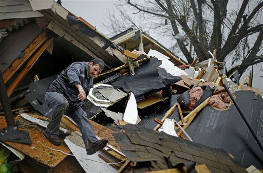 "<div class=""meta ""><span class=""caption-text "">Nathan Varnes, of Cartersville, Ga., helps search a destroyed home for a dog after a tornado struck, Wednesday, Jan. 30, 2013, in Adairsville, Ga. A fierce storm system that roared across Georgia has left at least one person dead after it demolished buildings and flipped vehicles on Interstate 75 northwest of Atlanta.  (AP Photo/ David Goldman)</span></div>"