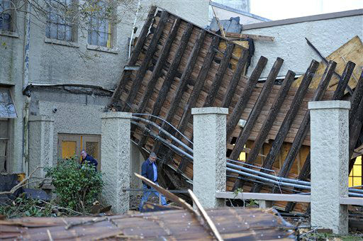 "<div class=""meta image-caption""><div class=""origin-logo origin-image ""><span></span></div><span class=""caption-text"">Murphy High School athletic custodian Mike Gill, left, and maintenance man Stewart Lynch, right, asses the damage caused to the school by a Christmas Day tornado as residents clean up at first light Wednesday, Dec. 26, 2012  in Mobile, Ala.  (AP Photo/ G.M. Andrews)</span></div>"