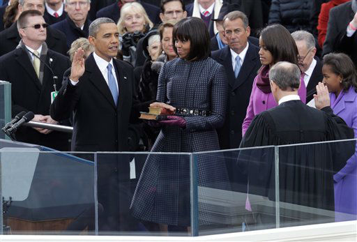 President Barack Obama takes the oath of office from Chief Justice John Roberts at the ceremonial swearing-in on the West Front of the U.S. Capitol during the 57th Presidential Inauguration in Washington, Monday, Jan. 21, 2013.  <span class=meta>(AP Photo&#47; Scott Andrews)</span>