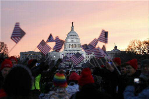 President Barack Obama supporters wave American flags on the National Mall in Washington, Monday, Jan. 21,  2013, prior to the start of President Barack Obama&#39;s ceremonial swearing-in ceremony during the 57th Presidential Inauguration.  <span class=meta>(AP Photo&#47; Jose Luis Magana)</span>