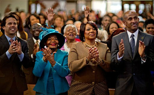 Dr. Bernice King, center right, and Christine King Farris, left, the daughter and sister of Dr. Martin Luther King Jr., applaud while watching a broadcast as President Barack Obama is inaugurated following the Dr. Martin Luther King Jr. holiday commemorative service at the Ebenezer Baptist Church, Monday, Jan. 21, 2013, in Atlanta.  <span class=meta>(AP Photo&#47; David Goldman)</span>