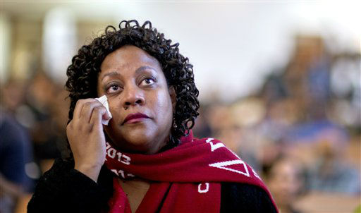 Herschelle Adams, of Atlanta, wipes away a tear while watching a broadcast of the inauguration of President Barack Obama following the Dr. Martin Luther King Jr. holiday commemorative service at the Ebenezer Baptist Church, Monday, Jan. 21, 2013, in Atlanta.  <span class=meta>(AP Photo&#47; David Goldman)</span>