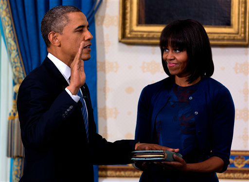 President Barack Obama takes the oath of office at the official swearing-in ceremony in the Blue Room of the White House in Washington, DC, Sunday, Jan. 20, 2013. <span class=meta>(AP Photo&#47; Doug Mills)</span>