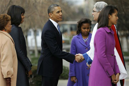 President Barack Obama, is greeted by Rev. Luis Leon, as he and his family arrives at St. John&#39;s Church in Washington, Monday, Jan. 21, 2013. for a church service during the 57th Presidential Inauguration. From left are, mother-in-law Marian Robinson, first lady Michelle Obama, the president,  Sasha Obama, Rev. Leon, and Malia Obama.   <span class=meta>(AP Photo&#47; Jacquelyn Martin)</span>
