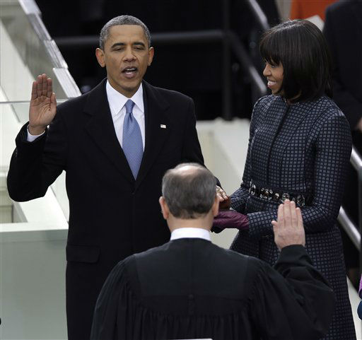 President Barack Obama receives the oath of office from Chief Justice John Roberts as first Lady Michelle holds the bible at the ceremonial swearing-in at the U.S. Capitol during the 57th Presidential Inauguration in Washington, Monday, Jan. 21, 2013. <span class=meta>(AP Photo&#47; Evan Vucci)</span>