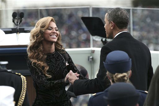 President Barack Obama greets singer Beyonce on the West Front of the Capitol in Washington, Monday, Jan. 21, 2013, after she sang the National Anthem during the president&#39;s ceremonial swearing-in ceremony during the 57th Presidential Inauguration.   <span class=meta>(AP Photo&#47; Win McNamee)</span>