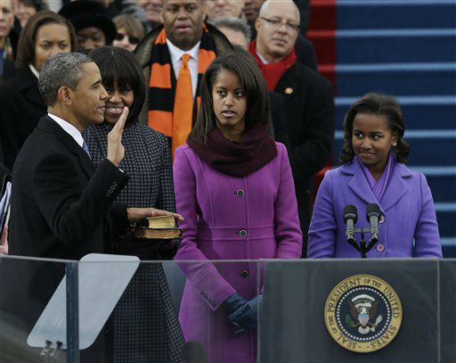 President Barack Obama&#39;s family watches during the ceremonial swearing-in at the U.S. Capitol during the 57th Presidential Inauguration in Washington, Monday, Jan. 21, 2013.  <span class=meta>(AP Photo&#47; Pablo Martinez Monsivais)</span>