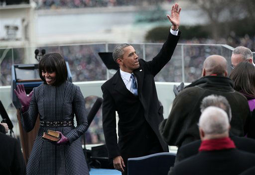 President Barack Obama, accompanied by first lady Michelle Obama, waves after being sworn in by Supreme Court Chief Justice John Roberts on the West Front of the Capitol in Washington, Monday, Jan. 21, 2013, during the 57th Presidential Inauguration.  <span class=meta>(AP Photo&#47; Win McNamee)</span>