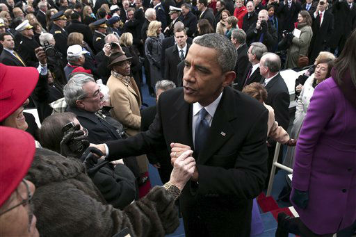 President Barack Obama greets people on the West Front of the Capitol in Washington, Monday, Jan. 21, 2013 in Washington, after the president&#39;s ceremonial swearing-in ceremony during the 57th Presidential Inauguration.   <span class=meta>(AP Photo&#47; Win McNamee)</span>