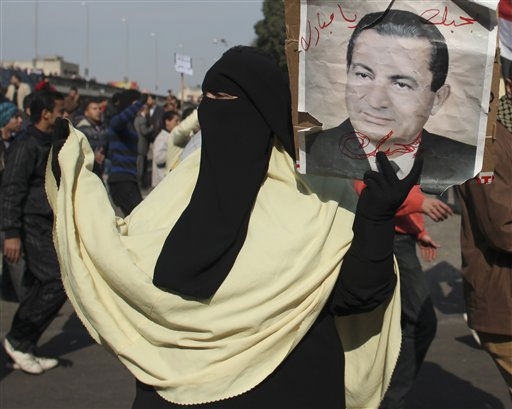 A  pro-government supporter holds a portrait of Egyptian President Hosni Mubarak in Cairo, Egypt, Wednesday, Feb.2, 2011. Several thousand supporters of President Hosni Mubarak, including some riding horses and camels and wielding whips, clashed with anti-government protesters Wednesday as Egypt&#39;s upheaval took a dangerous new turn.  <span class=meta>(AP Photo&#47; Tara Todras-Whitehill)</span>