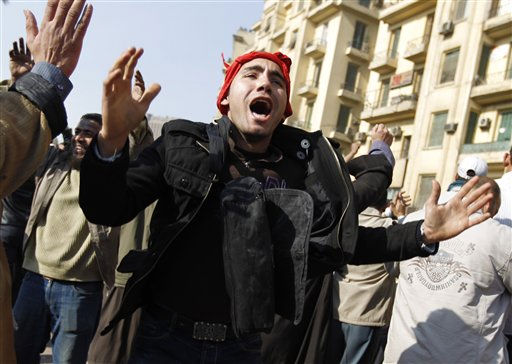 A demonstrator reacts during clashes between pro-government supporters and anti-government protestors in Cairo, Egypt, Wednesday, Feb.2, 2011. Several thousand supporters of President Hosni Mubarak, including some riding horses and camels and wielding whips, clashed with  anti-government protesters Wednesday as Egypt&#39;s upheaval took a dangerous new turn.  <span class=meta>(AP Photo&#47; Tara Todras-Whitehill)</span>