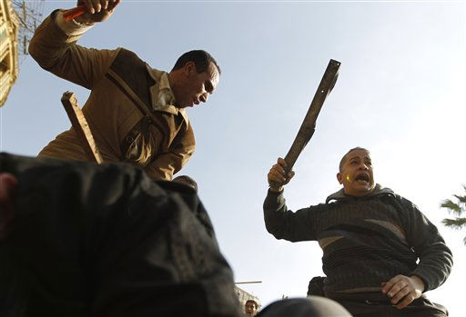 Demonstrators use sticks during clashes between pro-government supporters and anti-government protestors in Cairo, Egypt, Wednesday, Feb.2, 2011. Several thousand supporters of President Hosni Mubarak, including some riding horses and camels and wielding whips, clashed with anti-government protesters Wednesday as Egypt&#39;s upheaval took a dangerous new turn.  <span class=meta>(AP Photo&#47; Tara Todras-Whitehill)</span>
