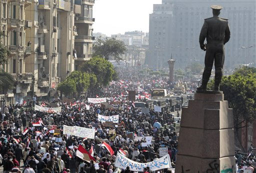 Pro-government supporters demonstrate in Cairo, Egypt, Wednesday, Feb.2, 2011. Several thousand supporters of President Hosni Mubarak, including some riding horses and camels and wielding whips, clashed with anti-government protesters Wednesday as Egypt&#39;s upheaval took a dangerous new turn. The statue is of Egyptian General Abdel Moneim Riyd. <span class=meta>(AP Photo&#47; Lefteris Pitarakis)</span>