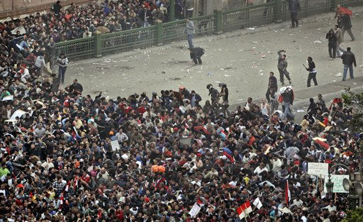 Those at the frontline of the anti-government demonstrators, above right, lead a charge against a crowd of pro-government demonstrators, below, in Tahrir square, the center of anti-government demonstrations, in Cairo, Egypt, Wednesday, Feb. 2, 2011.  <span class=meta>(AP Photo&#47; Ben Curtis)</span>