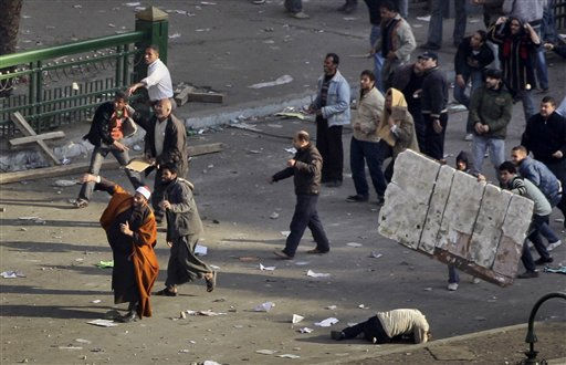 Anti-government demonstrators, including a Muslim cleric, throw projectiles at pro-government demonstrators, unseen, during clashes between the two sides in Tahrir square in Cairo, Egypt, Wednesday, Feb. 2, 2011.  <span class=meta>(AP Photo&#47; Ben Curtis)</span>