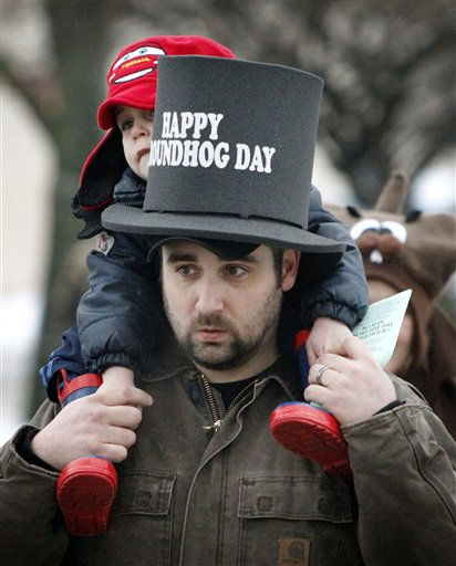 Paul Porter, from Parkersburg, W.Va. gives his three-year-old son, Peyton, a ride on his shoulders as they visit Punxsutawney, Pa. on Tuesday, Feb. 1, 2011.  <span class=meta>(AP Photo&#47; Keith Srakocic)</span>