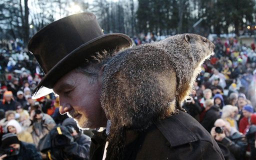 "<div class=""meta ""><span class=""caption-text "">Punxsutawney Phil, the weather predicting groundhog, stands on the shoulder of one of his handlers John Griffiths after the Groundhog Club claimed that Phil did not see his shadow and winter has ended on Groundhog Day, Wednesday, Feb. 2, 2011, in Punxsutawney, Pa.  (AP Photo/ Keith Srakocic)</span></div>"