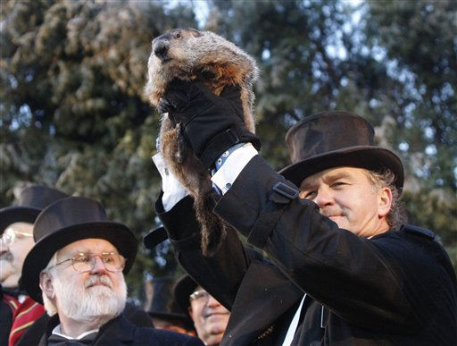 Groundhog Club handler John Griffiths holds Punxsutawney Phil, the weather predicting groundhog, during annual Groundhog Day festivities Wednesday, Feb. 2, 2011, in Punxsutawney, Pa. The Groundhog Club claimed that Phil did not see his shadow and predicted that winter has ended on Groundhog Day.  <span class=meta>(AP Photo&#47; Keith Srakocic)</span>