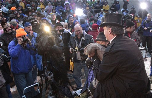 "<div class=""meta image-caption""><div class=""origin-logo origin-image ""><span></span></div><span class=""caption-text"">Groundhog Club handler John Griffiths holds Punxsutawney Phil, the weather predicting groundhog, for photographers and cameramen during annual Groundhog Day festivities Wednesday, Feb. 2, 2011, in Punxsutawney, Pa. The Groundhog Club claimed that Phil did not see his shadow and predicted that winter has ended on Groundhog Day.  (AP Photo/ Keith Srakocic)</span></div>"