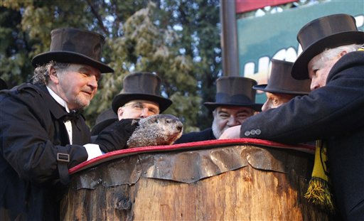 Groundhog Club President Bill Deeley, right, looks and listens to Punxsutawney Phil,  the weather predicting groundhog, as handler John Griffiths, left, awaits the prediction that winter has ended on Groundhog Day, Wednesday, Feb. 2, 2011, in Punxsutawney, Pa.  <span class=meta>(AP Photo&#47; Keith Srakocic)</span>