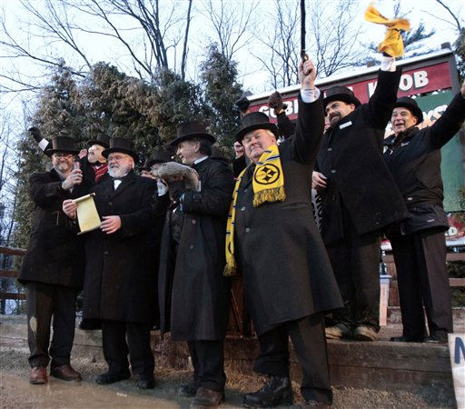 "<div class=""meta ""><span class=""caption-text "">Groundhog Club President Bill Deeley, front right, stands with the rest of the Inner Circle of the Groundhog Club as Vice President Mike Johnston, center left, reads the proclamation that Punxsutawney Phil,  the weather predicting groundhog predicted that winter has ended on Groundhog Day, Wednesday, Feb. 2, 2011, in Punxsutawney, Pa. (AP Photo/ Keith Srakocic)</span></div>"