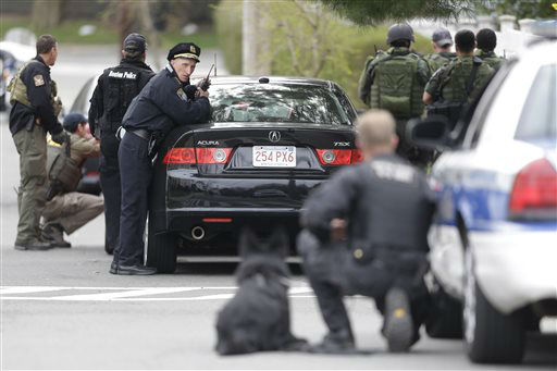 "<div class=""meta image-caption""><div class=""origin-logo origin-image ""><span></span></div><span class=""caption-text"">Police officers take cover as they conduct a search for a suspect in the Boston Marathon bombings, Friday, April 19, 2013, in Watertown, Mass.   (AP Photo/ Matt Rourke)</span></div>"