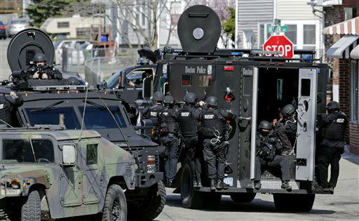 Tactical teams drive through a neighborhood while searching for a suspect in the Boston Marathon bombings in Watertown, Mass., Friday, April 19, 2013.   <span class=meta>(AP Photo&#47; Charles Krupa)</span>