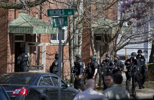 Heavily armed police enter a building in Watertown, Mass. Friday, April 19, 2013, as law enforcement officials continue a massive search for one of two suspects in the Boston Marathon bombing.  <span class=meta>(AP Photo&#47; Craig Ruttle)</span>