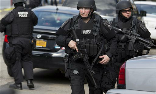 Heavily armed police continue to patrol the neighborhoods of Watertown, Mass. Friday, April 19, 2013, as they continue a massive search for one of two suspects in the Boston Marathon bombing. <span class=meta>(AP Photo&#47; Craig Ruttle)</span>