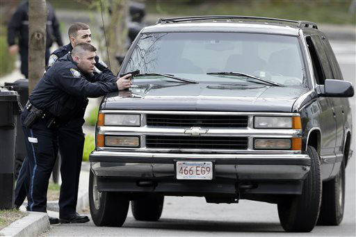 "<div class=""meta ""><span class=""caption-text "">Police officers take cover as they conduct a search for a suspect in the Boston Marathon bombings, Friday, April 19, 2013, in Watertown, Mass.  (AP Photo/ Matt Rourke)</span></div>"