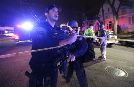 "<div class=""meta ""><span class=""caption-text "">Officials secure an area in Watertown, Mass., Friday, April 19, 2013.  (AP Photo/ Julio Cortez)</span></div>"