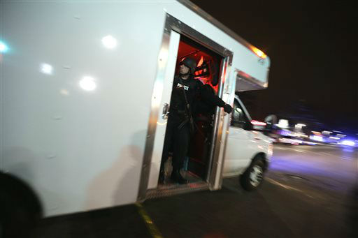 "<div class=""meta ""><span class=""caption-text "">A vehicle carrying officers in tactical gear arrives at the Watertown neighborhood of Boston, Friday, April 19, 2013.  (AP Photo/ Julio Cortez)</span></div>"