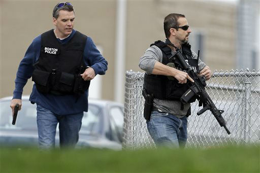 Police run with their weapons drawn as they conduct a search for a suspect in the Boston Marathon bombings, Friday, April 19, 2013, in Watertown, Mass.   <span class=meta>(AP Photo&#47; Matt Rourke)</span>
