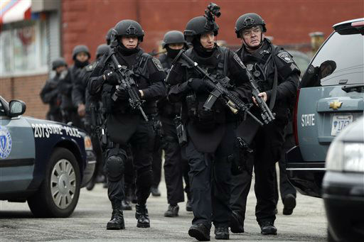 Police in tactical gear conduct a search for a suspect in the Boston Marathon bombings, Friday, April 19, 2013, in Watertown, Mass.  <span class=meta>(AP Photo&#47; Matt Rourke)</span>