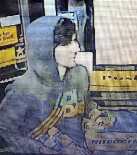 This surveillance photo released via Twitter Friday, April 19, 2013 by the Boston Police Department shows a suspect entering a convenience store that police are pursuing in Watertown, Mass.  Police say he is one of two suspects in the fatal shooting of an MIT police officer and tied to the Boston Marathon bombing. <span class=meta>(AP Photo&#47; Uncredited)</span>