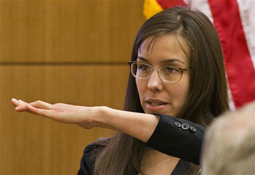 Defendant Jodi Arias shows the jury her deformed finger during cross examination by prosecutor Juan Martinez  in Maricopa County Superior Court, Thursday, Feb. 21, 2013 in Phoenix.   <span class=meta>(AP Photo&#47; Tom Tingle)</span>