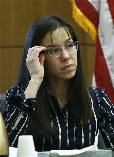 "<div class=""meta image-caption""><div class=""origin-logo origin-image ""><span></span></div><span class=""caption-text"">Jodi Arias adjusts her glasses as she sits in the witness stand in Maricopa County Superior Court, Wednesday, Feb. 13, 2013, in Phoenix.  (AP Photo/ Ross D. Franklin)</span></div>"