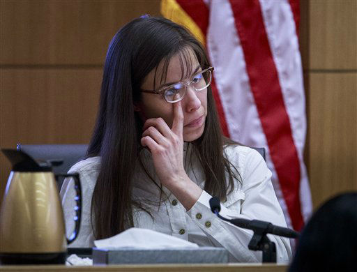 "<div class=""meta image-caption""><div class=""origin-logo origin-image ""><span></span></div><span class=""caption-text"">Defendant Jodi Arias talks about the text messages with Travis Alexander from March through May 2008, as she testifies in her murder trial on Tuesday, Feb. 19, 2013. (AP Photo/ Charlie Leight)</span></div>"
