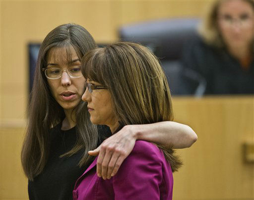 Jodi Arias, left,  demonstrates how she had her arm around her sister in a photograph that had been admitted into evidence  Monday March 4, 2013 in Phoenix.   <span class=meta>(AP Photo&#47; Tom Tingle)</span>