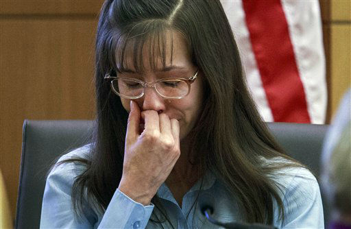 Defendant Jodi Arias loses her composure as she testifies about killing Travis Alexander in 2008 during her murder trial at Judge Sherry Stephens&#39;   Maricopa County Superior Court  in Phoenix on Wednesday, Feb. 20, 2013.    <span class=meta>(AP Photo&#47; Charlie Leight)</span>