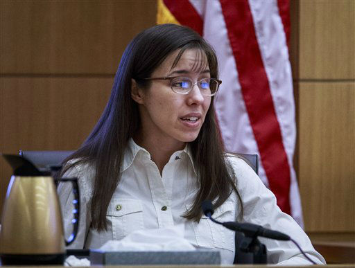 "<div class=""meta ""><span class=""caption-text "">Defendant Jodi Arias talks about the text messages with Travis Alexander from March through May 2008, as she testifies in her murder trial on Tuesday, Feb. 19, 2013.   (AP Photo/ Charlie Leight)</span></div>"