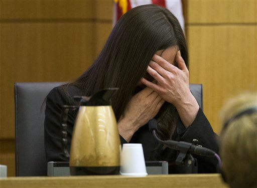 "<div class=""meta ""><span class=""caption-text "">Jodi Arias breaks down after being asked by prosecutor Juan Martinez if she was crying when she stabbed Travis Alexander and when she slit his throat,  during cross examination at Arias' murder trial on Thursday, Feb. 28, 2013 in Phoenix. (AP Photo/ Tom Tingle)</span></div>"