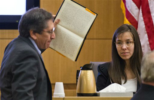 "<div class=""meta image-caption""><div class=""origin-logo origin-image ""><span></span></div><span class=""caption-text"">Prosecutor Juan Martinez asks defendant Jodi Arias a question about her diary during cross examination testimony in Maricopa County Superior Court, Thursday, Feb. 21, 2013 in Phoenix.   (AP Photo/ Tom Tingle)</span></div>"