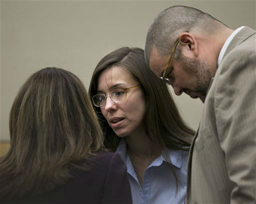 "<div class=""meta ""><span class=""caption-text "">Jodi Arias talks to defense attorneys Jennifer Wilmott and Kirk Nurmi during the Jodi Arias trial at Maricopa County Superior Court in Phoenix on Wednesday, April 3, 2013.  (AP Photo/ David Wallace)</span></div>"